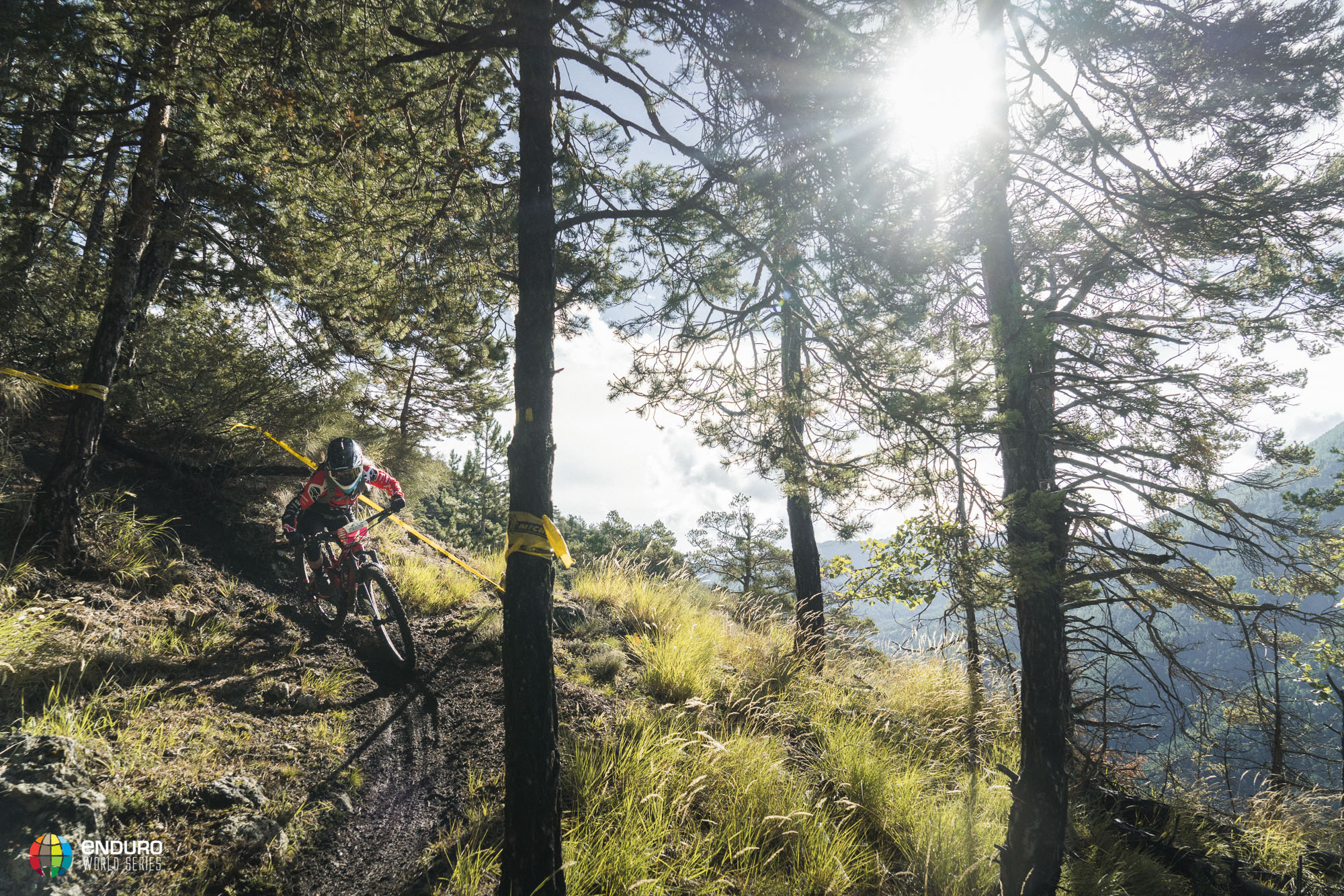 Isabeau Courderier fights the slick singletrack on stage 1